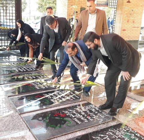 آیین غیار روبی و عطر افشانی مزار شهدا به مناسبت فرا رسیدن دهه پرفروغ فجر