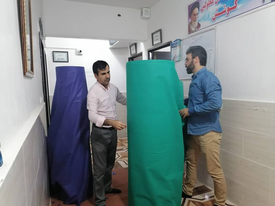تولید لباس بیمارستانی  و روکش چکمه توسط گروه همیار زنان سرپرست خانوار دزفول