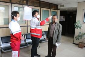گزارش تصویری| تب سنجی کارکنان حاضر در محل کار