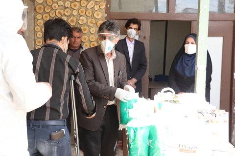 توزیع غذا و اقلام بهداشتی در بین معتادین متهاجر