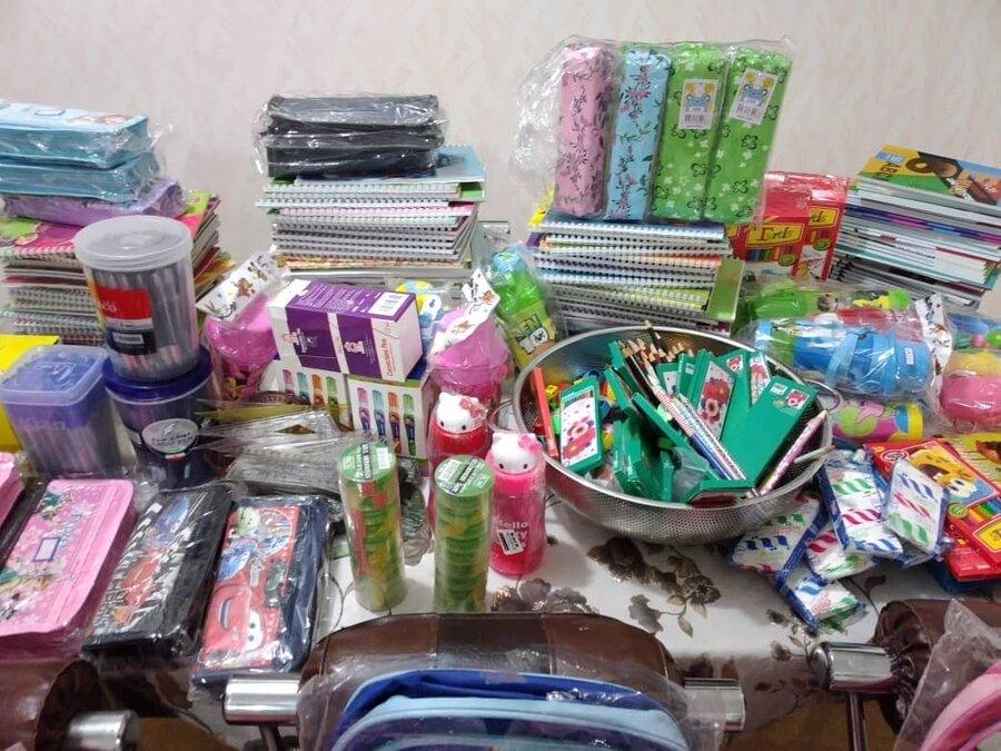 دهلران| گزارش تصویری| اهدا  ۱۰۰ بسته لوازم التحریر به دانش آموزان مددجوی بهزیستی دهلران